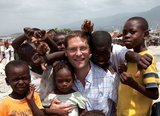 Magnus Macfarlane-Barrow is mobbed by children in Haiti