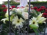 Flowers before Our Lady statue