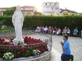 Praying before Our Lady statue