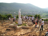 Praying before the statue of Our Lady statue at Podbrdo