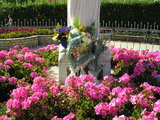 Flowers put at the foot of Statue of Queen of Peace